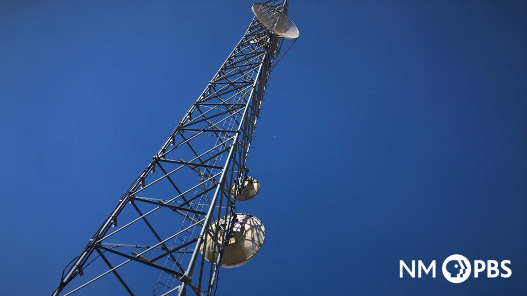 Low view of a giant television tower.