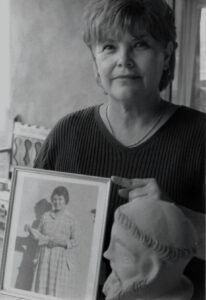 Quirina Córdova Medina holding a photo of her grandmother Isabel Córdova.