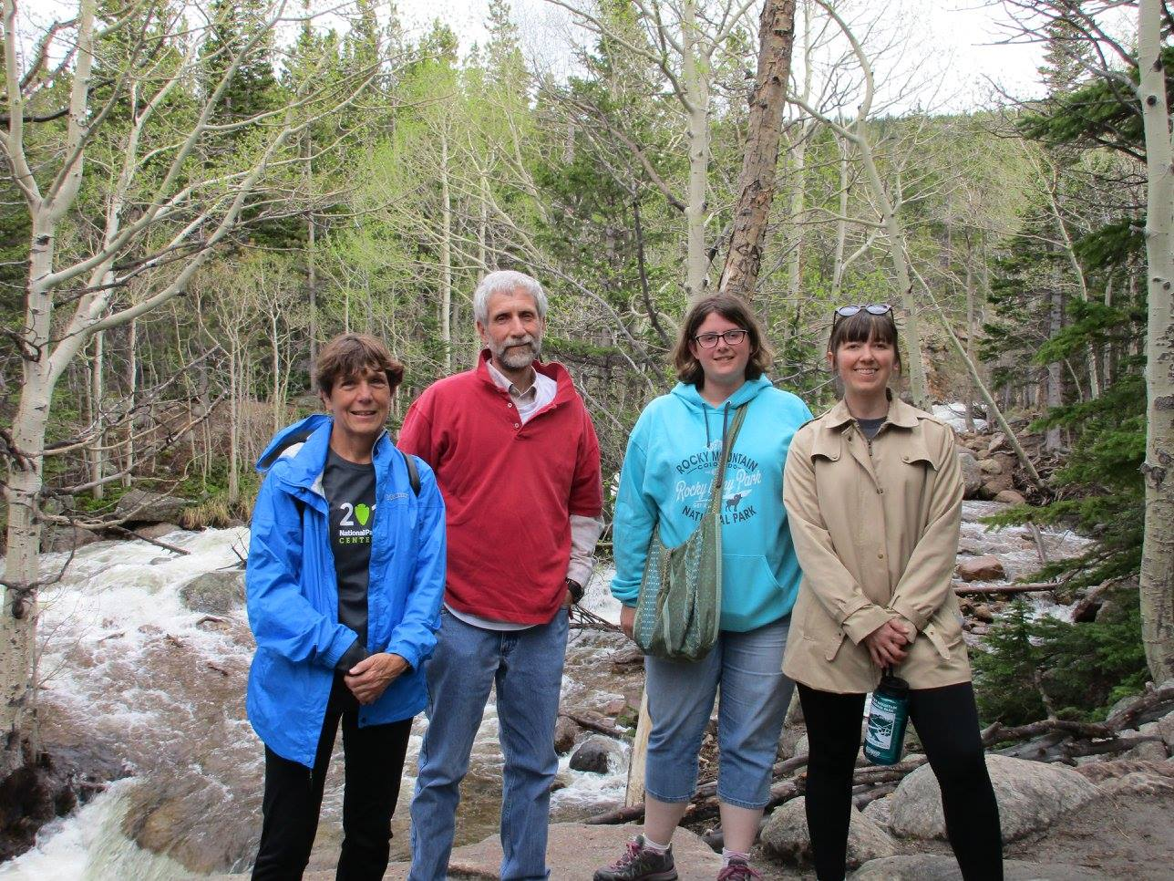 AAPB Team stands amid a forest area in the Rocky Mountains.
