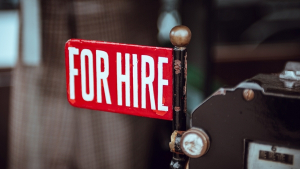 """A red sign reads """"For Hire""""."""